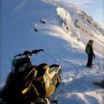 evening sun on your snowmobile tour