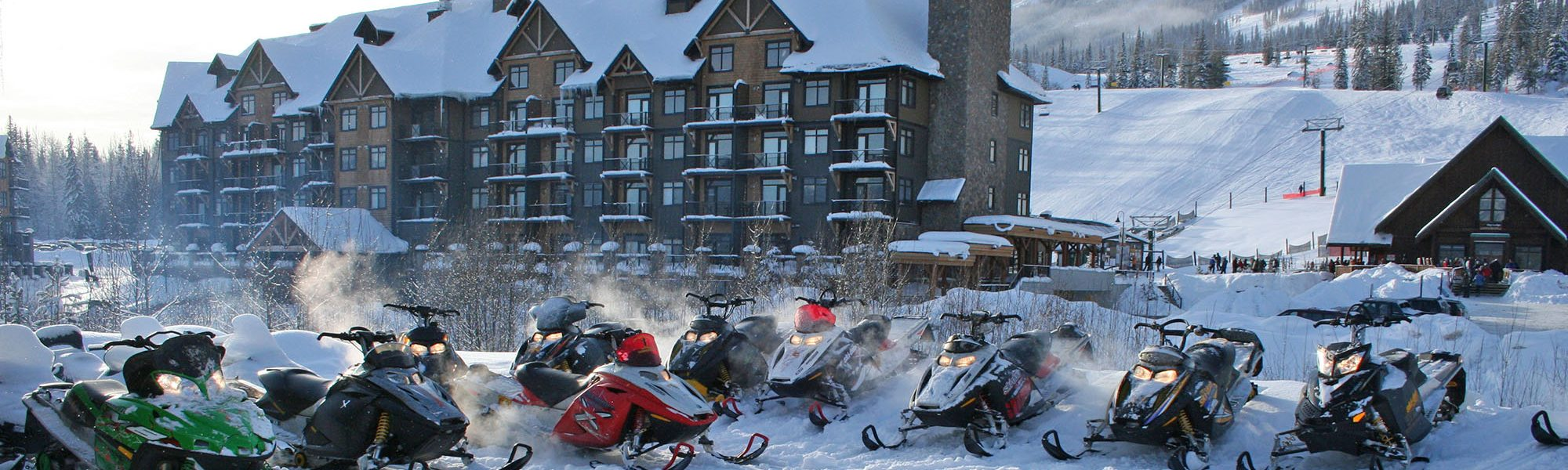 snowmobile tours at kicking horse resort