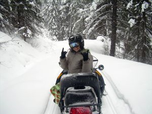 enjoy a snowmobile tour on the trails around golden bc